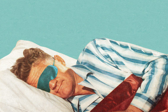 An old fashion image of a man sleeping with an original -style eye mask in the 50s
